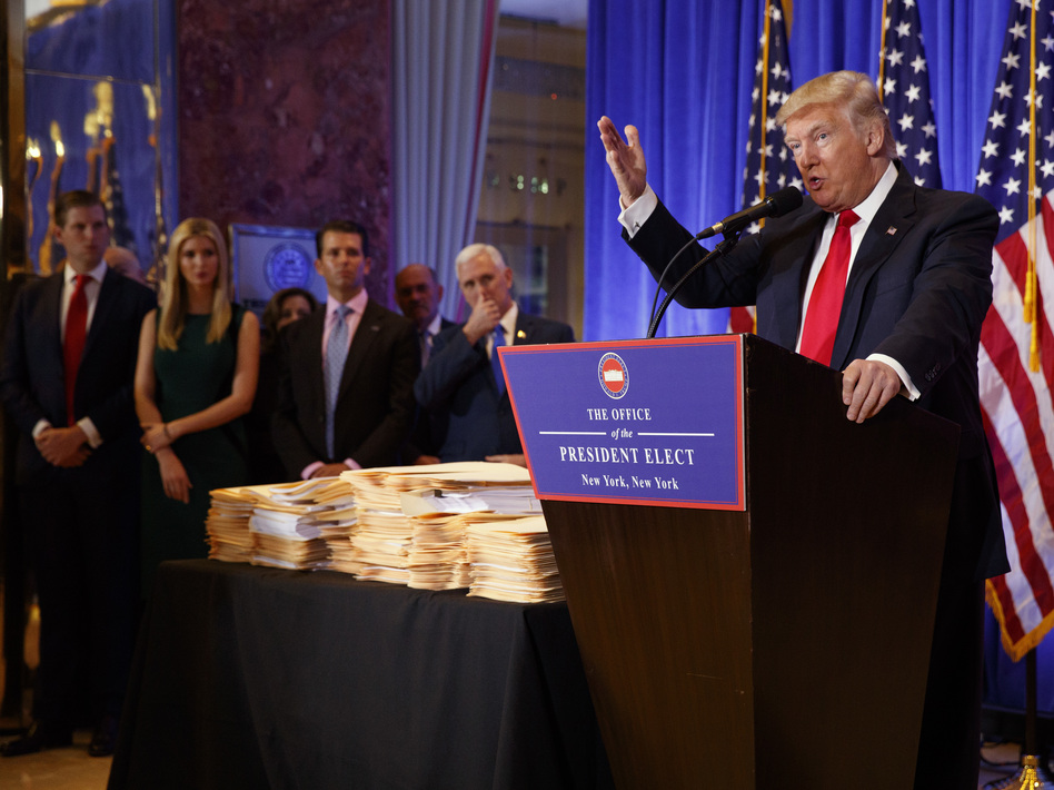 President-elect Donald Trump speaks during a news conference in the lobby of Trump Tower in New York on Wednesday, during which he discussed plans to shift management of his businesses to his sons. (Evan Vucci/AP)