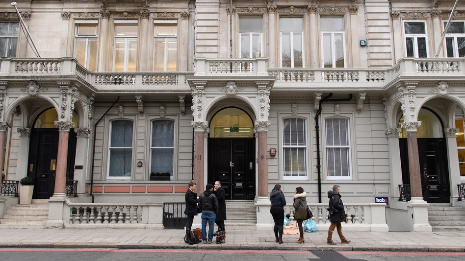 Journalists gather outside the London headquarters of Orbis Business Intelligence, the company co-owned by former British intelligence officer Christopher Steele, on Thursday. (Leon Neal/Getty Images)