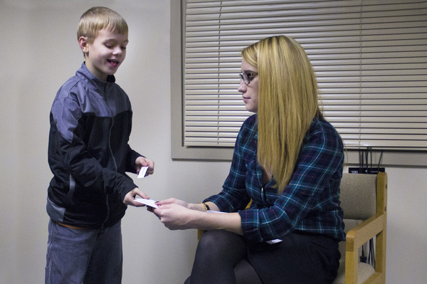 Shaw, 8, plays an improv game with Erin McTiernan, an Indiana State University doctoral student. Shaw is a participant in an improv class at Indiana State University for children with high functioning autism.