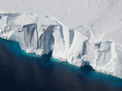 Calving is a natural process that produces icebergs, as seen here with the Getz Ice Shelf in West Antarctica.