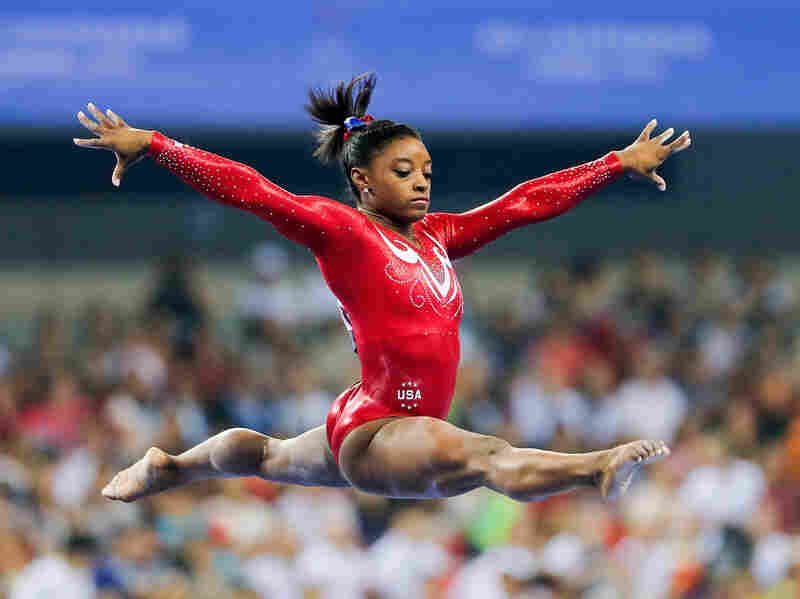 Simone Biles performs on the balance beam at the 45th Artistic Gymnastics World Championships in Nanning, China in October 2014.