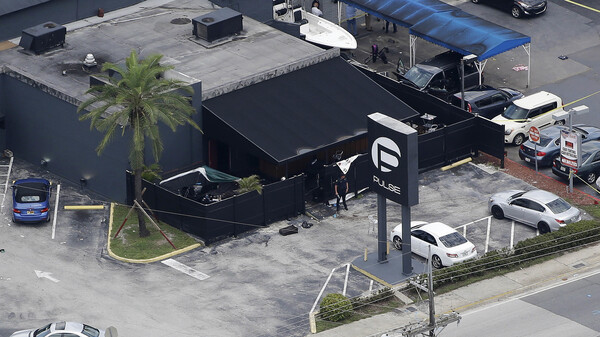 Law enforcement officials work at the Pulse nightclub in Orlando, Fla., in June following the mass shooting.