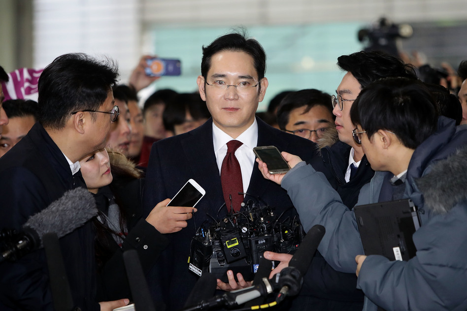 J.Y. Lee, vice chairman of Samsung Electronics, arrives at the office of the independent counsel last Thursday in Seoul, South Korea. Prosecutors are now seeking an arrest warrant for Lee. (Chung Sung-Jun/Getty Images)