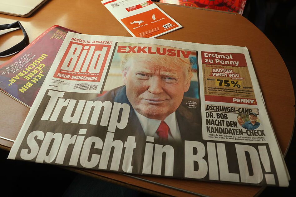 A copy of the German newspaper Bild Zeitung featuring an exclusive interview with U.S. President-elect Donald Trump lies on a table in a train on Monday in Berlin. (Sean Gallup/Getty Images)