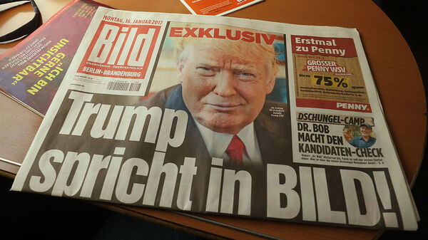 A copy of the German newspaper Bild Zeitung featuring an exclusive interview with U.S. President-elect Donald Trump lies on a table in a train on Monday in Berlin.