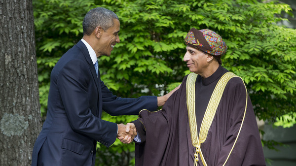 President Obama shakes hands with Oman