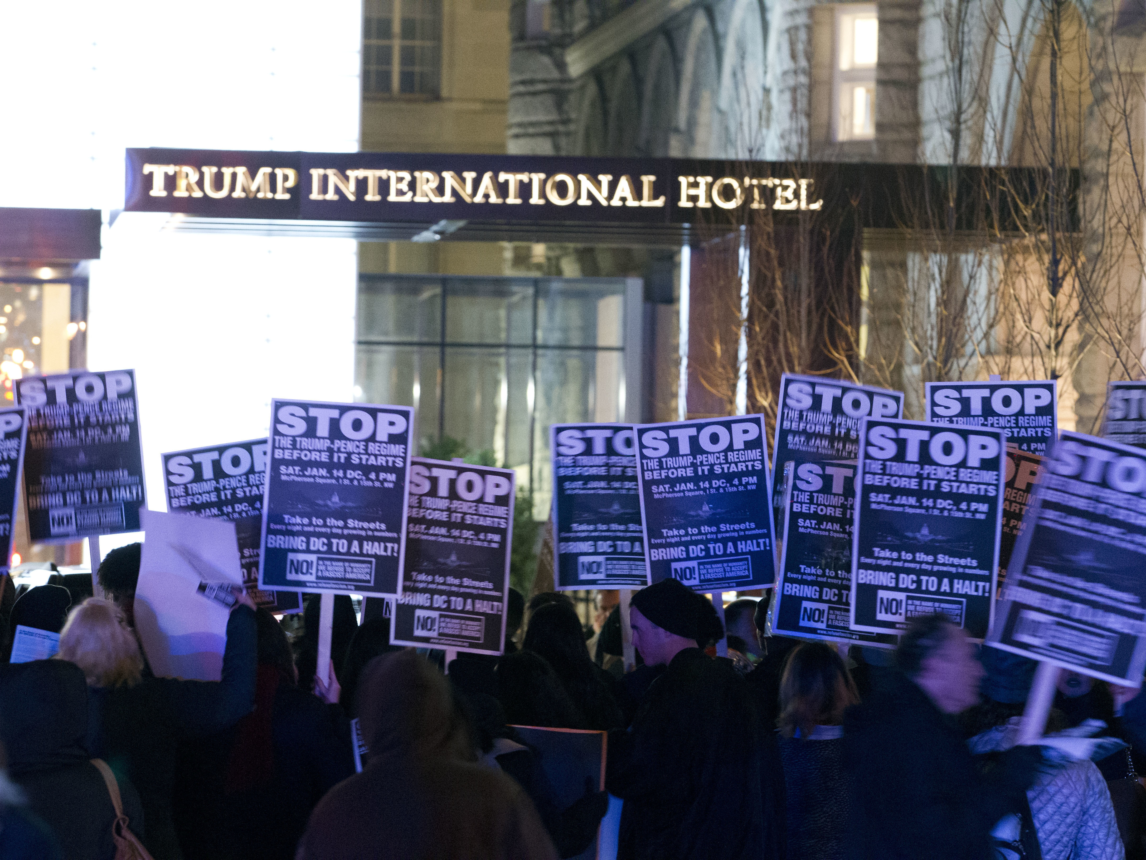 Demonstrators protest outside the Trump International Hotel in Washington, D.C., on Jan. 15. (Jose Luis Magana/AP)