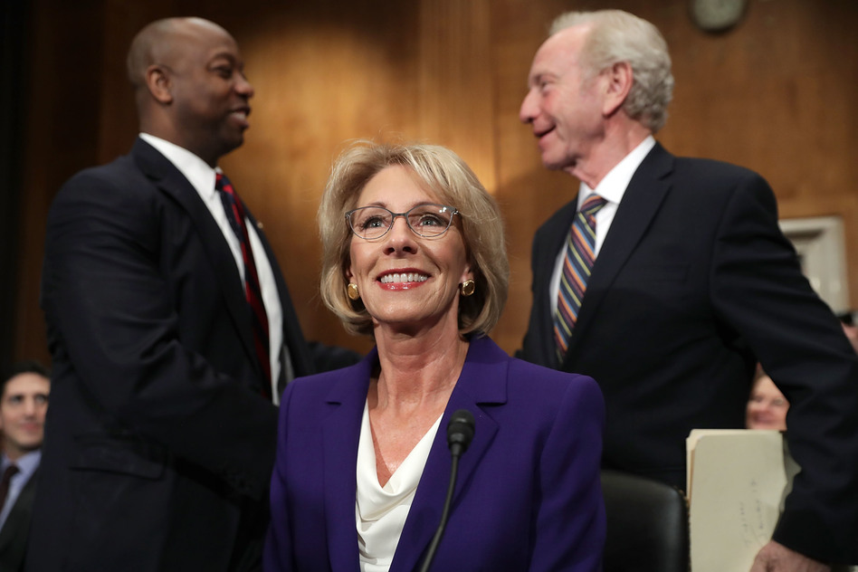 Betsy DeVos prepares to testify at her confirmation hearing. (Chip Somodevilla/Getty Images)