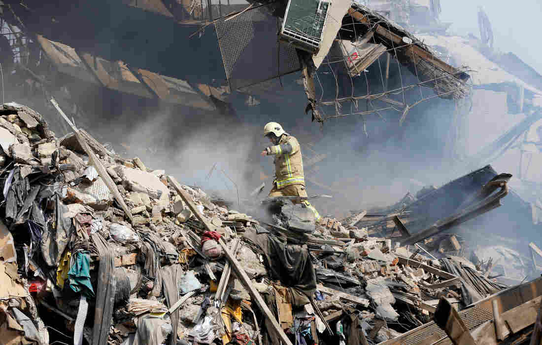 High-Rise Collapses In Tehran, Killing Firefighters Working Inside - NPR