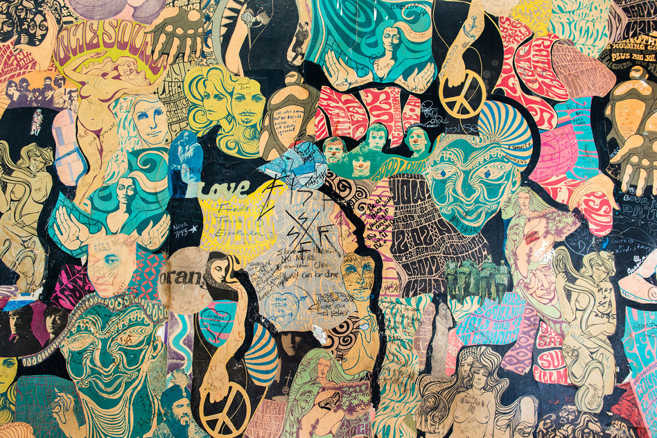 A large collage decorates a wall of one exam room at the Haight Ashbury Free Medical Clinic in San Francisco, Calif. Dr. David Smith, founder of the clinic, says patients and staff call the mural the Psychedelic Wall of Fame. (Heidi de Marco/Kaiser Health News)