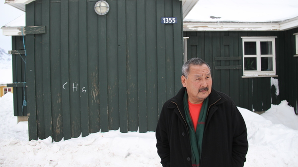 Orto Ignatiussen outside his home in Tasiilaq, Greenland, in 2016.