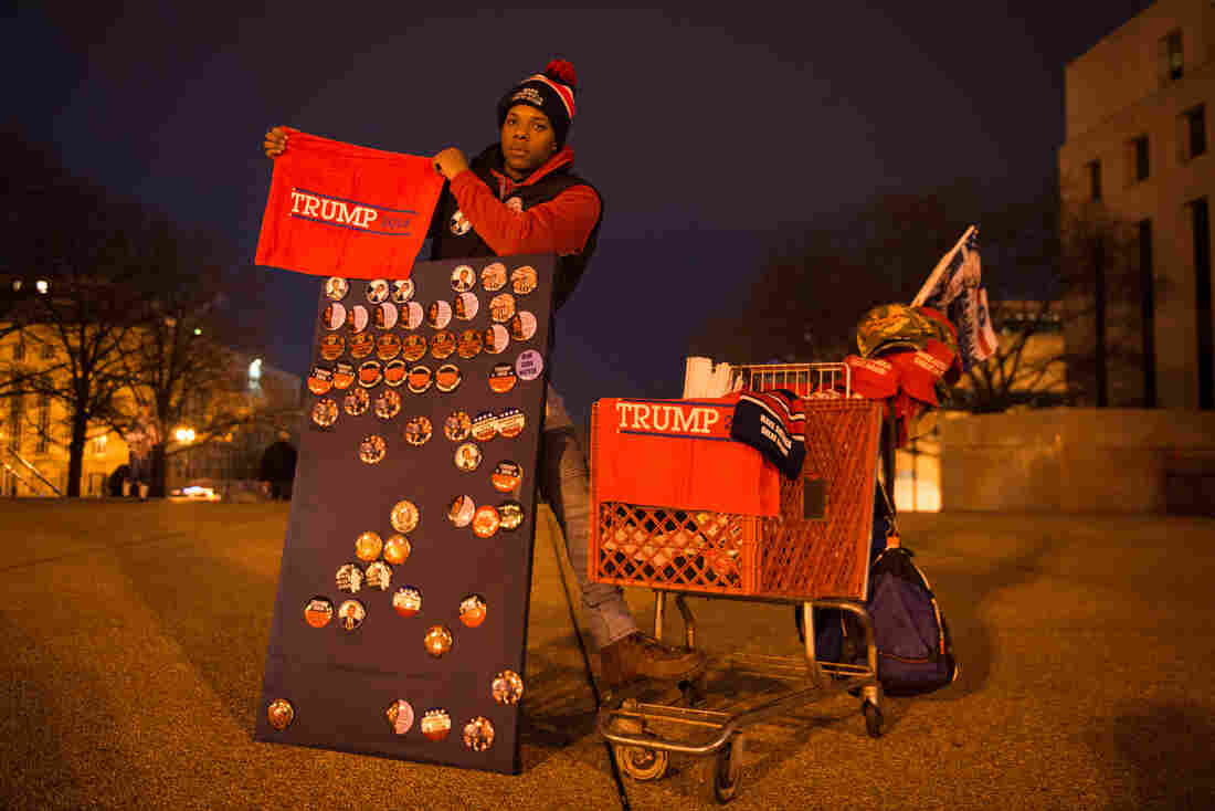 Timothy Moore stands outside one of the entry points to the National Mall selling Trump merchandise to earn money for college. His most-sold item is the Trump towels.