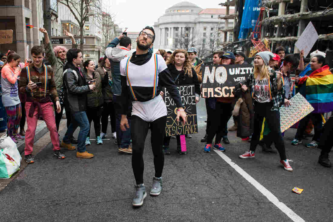 Firas Nasr dances amongst a group of LGBT-affiliated protesters as they block one of the entries to the presidential inauguration parade route.