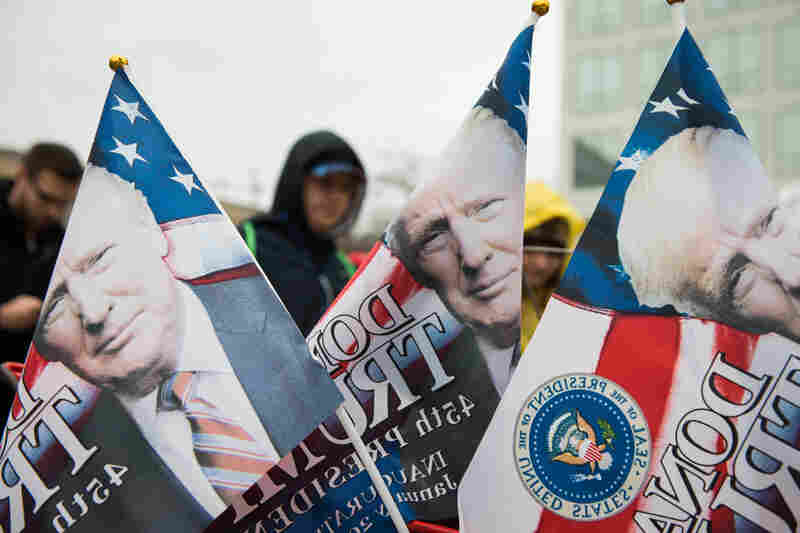 Flags printed with President Trump's face are sold outside one of the entrances to the National Mall.
