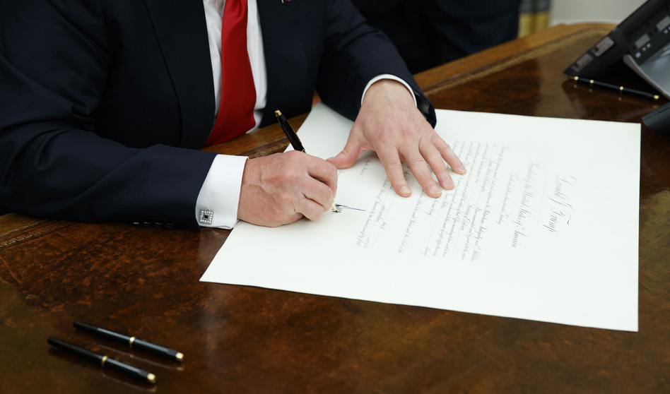 President Trump signs a confirmation for James Mattis to be defense secretary, Friday in the Oval Office. (Evan Vucci/AP)