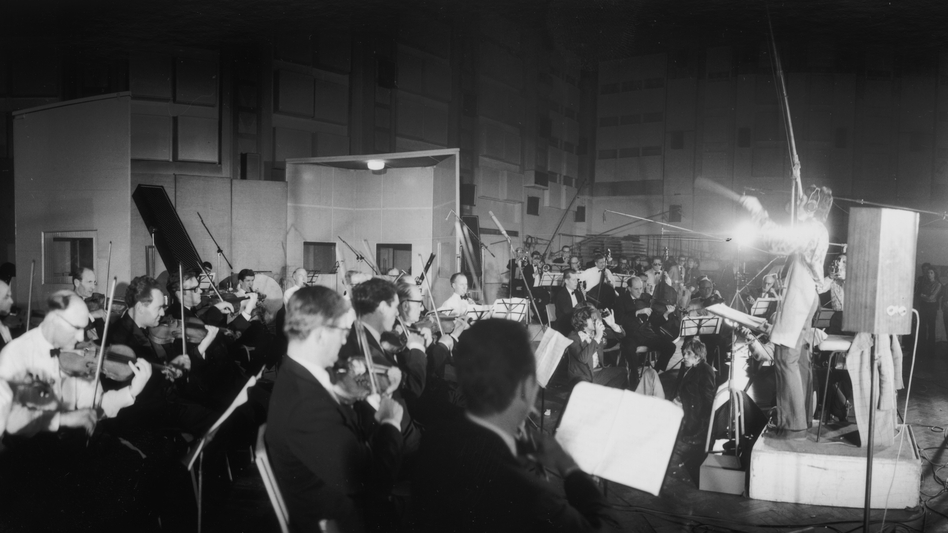 Paul McCartney conducts a 40-piece orchestra during recording sessions for Sgt. Pepper's Lonely Hearts Club Band. (Getty Images)