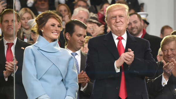 US President Donald Trump, his wife Melania and other family members arrive in the official tribune to review marching band performing in the Presidential Inaugural Parade.