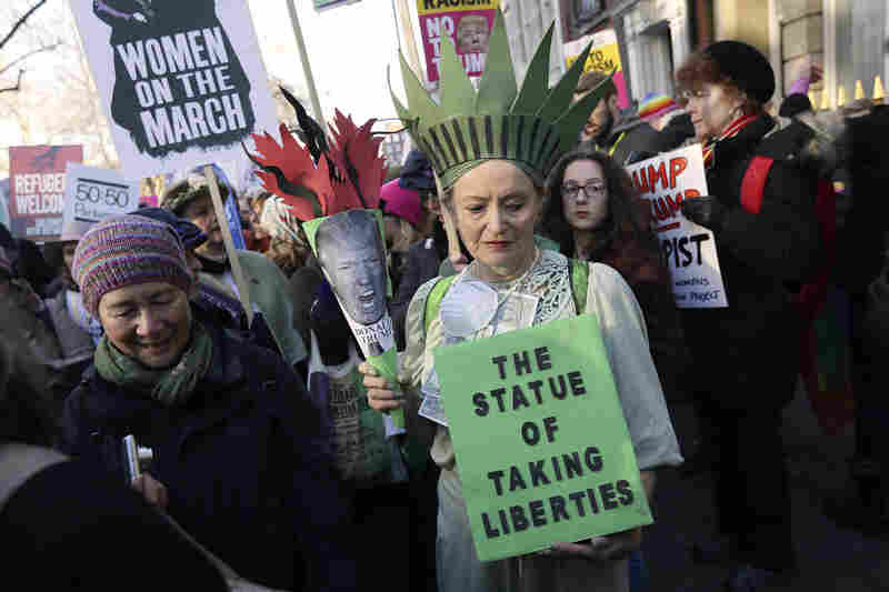 Demonstrators take part in the Women's March on London on Saturday.