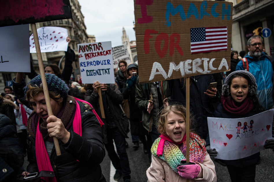 Demonstrators bear their signs at the women's march in Barcelona, Spain. The Spaniards drew inspiration from the Women's March on Washington, but due to the time difference, they actually hit the streets before the Americans. (David Ramos/Getty Images)