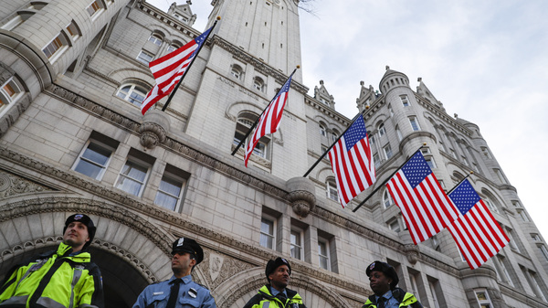 Police stand guard outside the Trump International Hotel in Washington the day before the inauguration. The president
