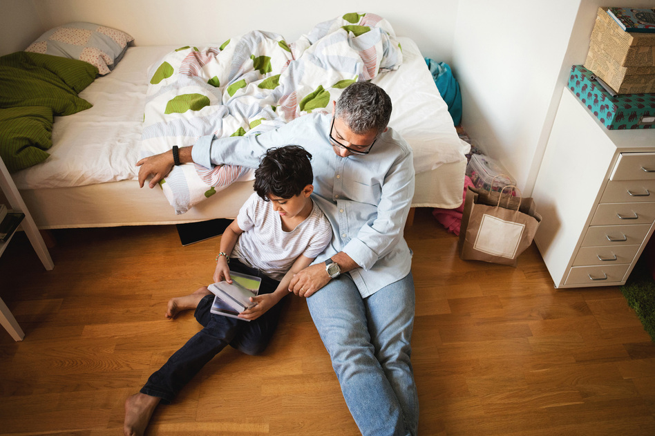 Giving dads a task — in this case, reading — seemed to suit them better than the kind of parenting classes favored by moms. (Maskot/Getty Images)