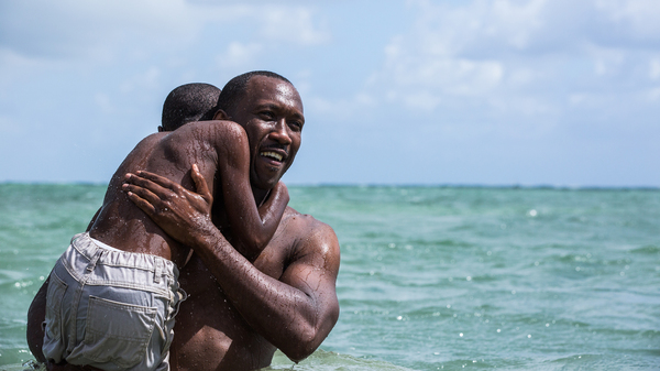Mahershala Ali holds Alex Hibbert in the film, Moonlight. Ali was nominated for an Oscar for supporting actor.