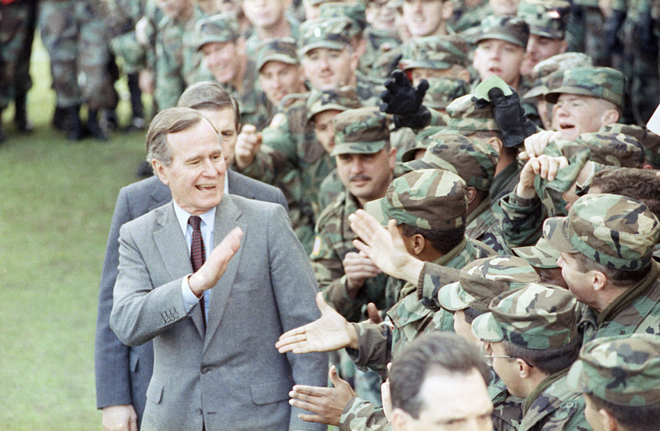 President George H.W. Bush greets soldiers at Fort Stewart, Ga., after he addressed family members of the 24th Infantry Division stationed in Saudi Arabia and personnel at the facility in February 1991. (Dennis Cook/AP)