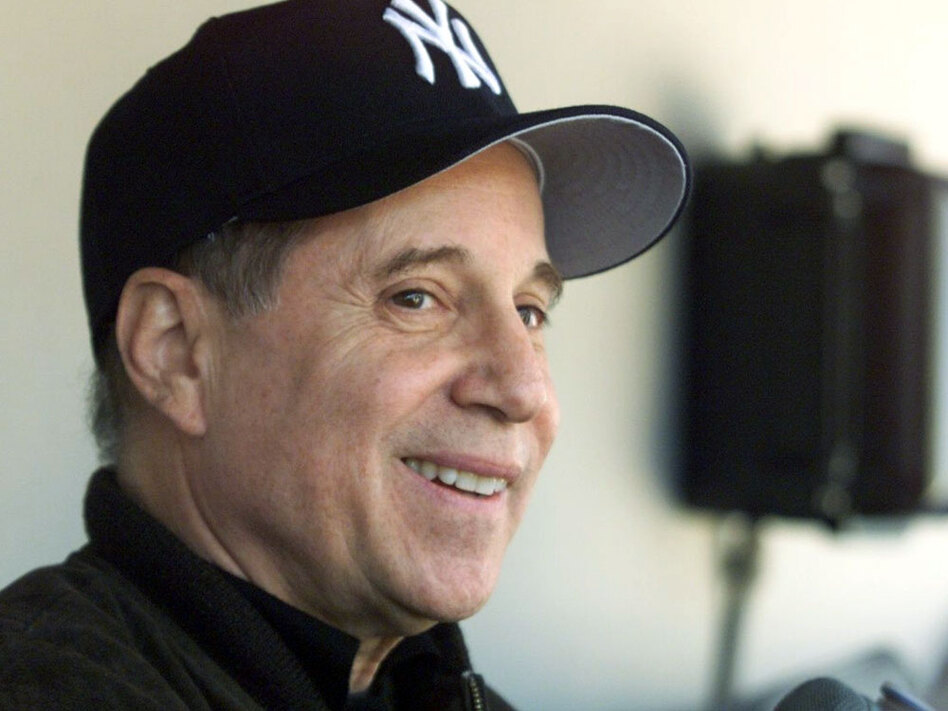Paul Simon collaborated with Philip Glass on the album <em>Songs from Liquid Days</em>.