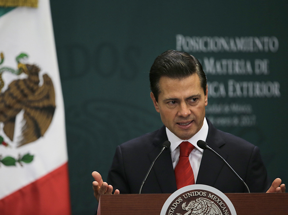 Mexico's President Enrique Peña Nieto speaks during a news conference in Mexico City on Monday. He is waiting to hear from high-level negotiators before deciding whether to cancel his U.S. trip. (Marco Ugarte/AP)