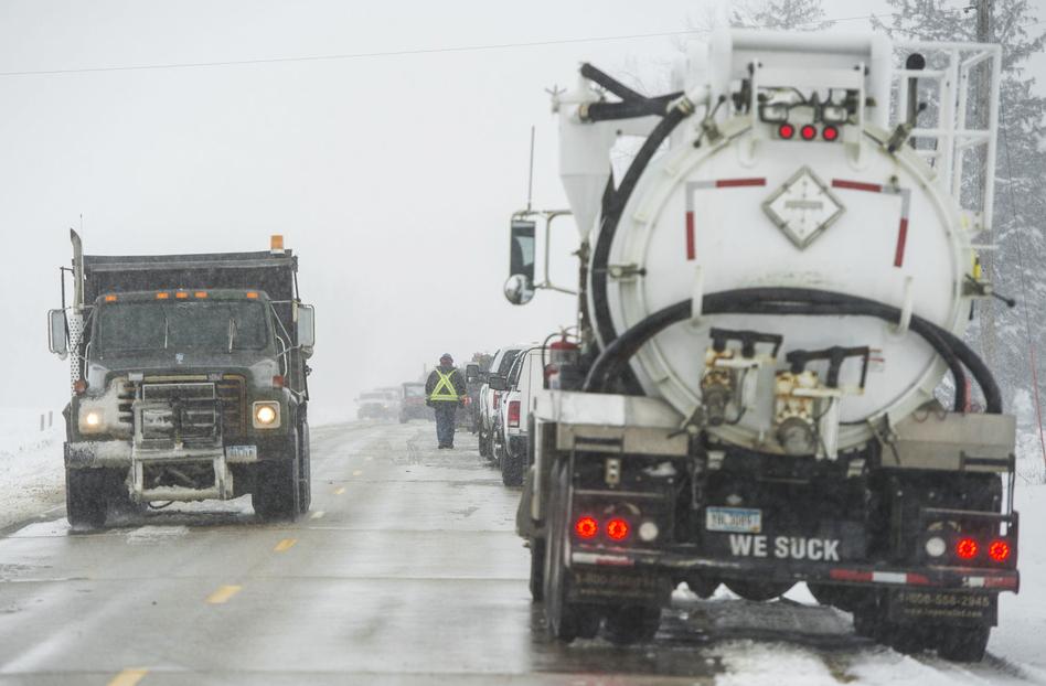 Crews clean up the diesel fuel spill after a pipeline broke in Worth County, Iowa on Wednesday. (Chris Zoeller/Mason City Globe Gazette/globegazette.com)
