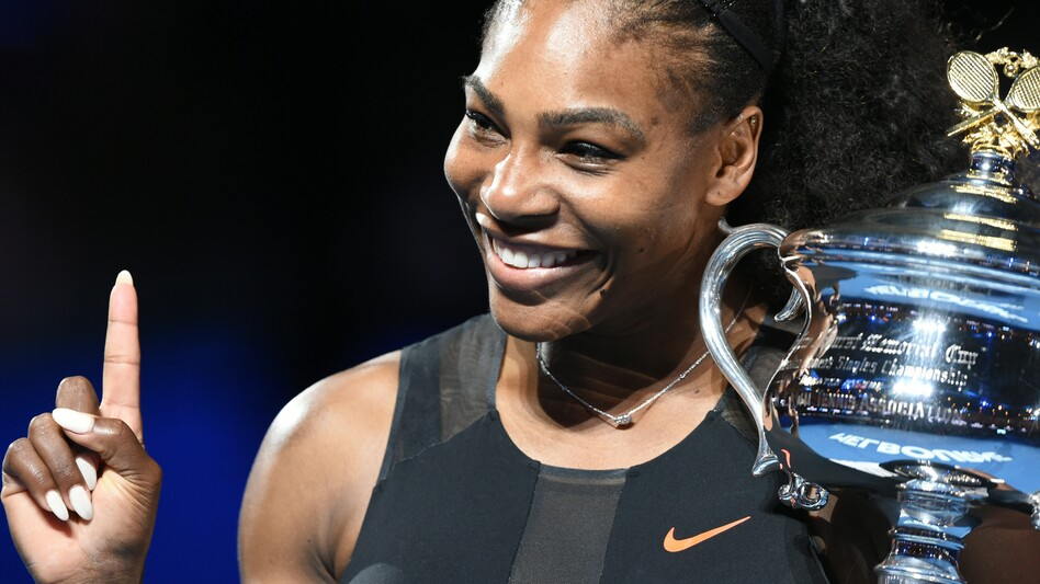 Serena Williams holds the winner's trophy following her victory in the women's singles final in the Australian Open in Melbourne Saturday. (Paul Crock/AFP/Getty Images)