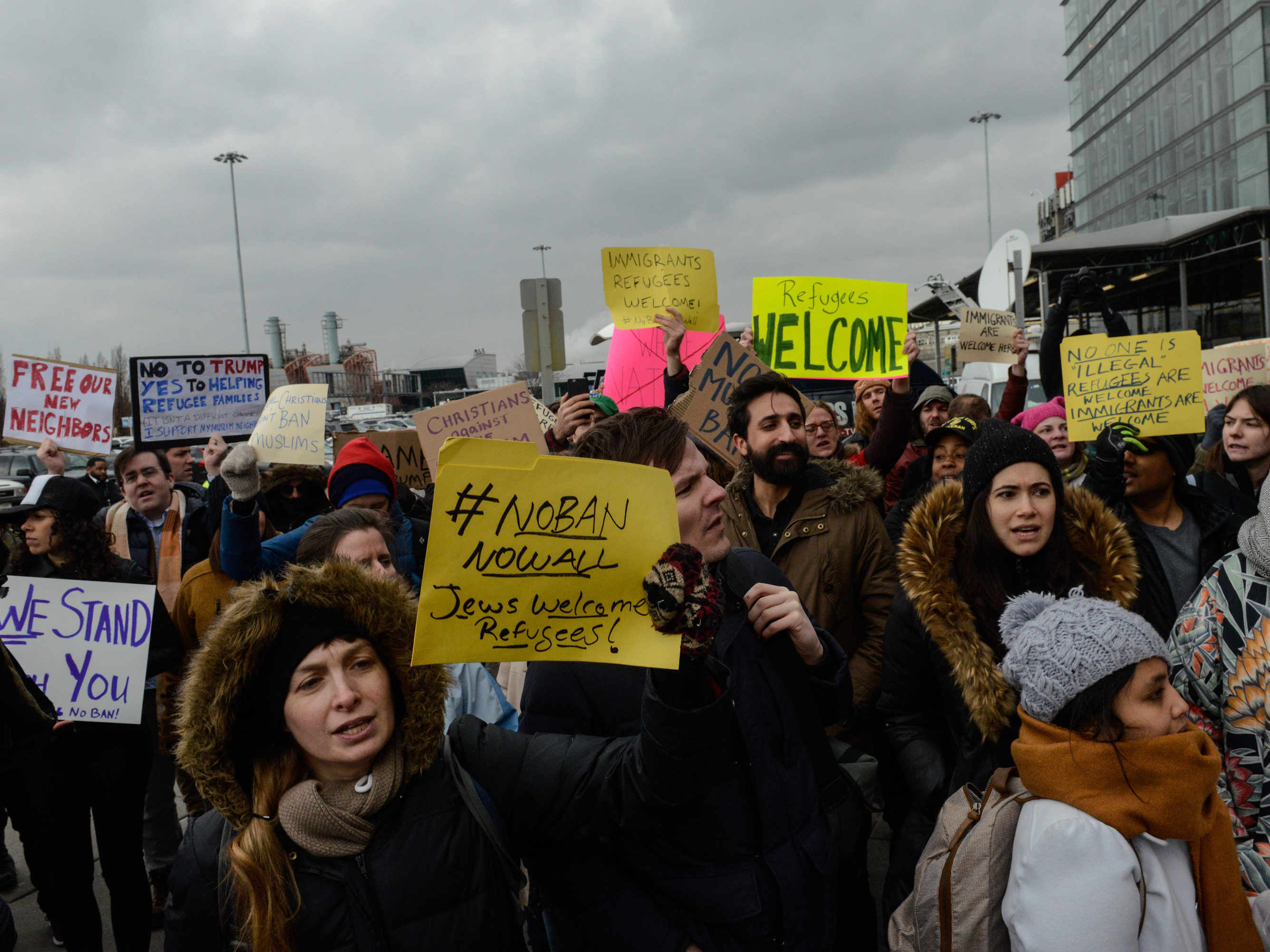 Protesters rally outside Kennedy International Airport to protest Trump's executive order on Saturday. New York City officials and immigrant advocates are holding are also holding a vigil at the airport Saturday evening. (Stephanie Keith/Getty Images)