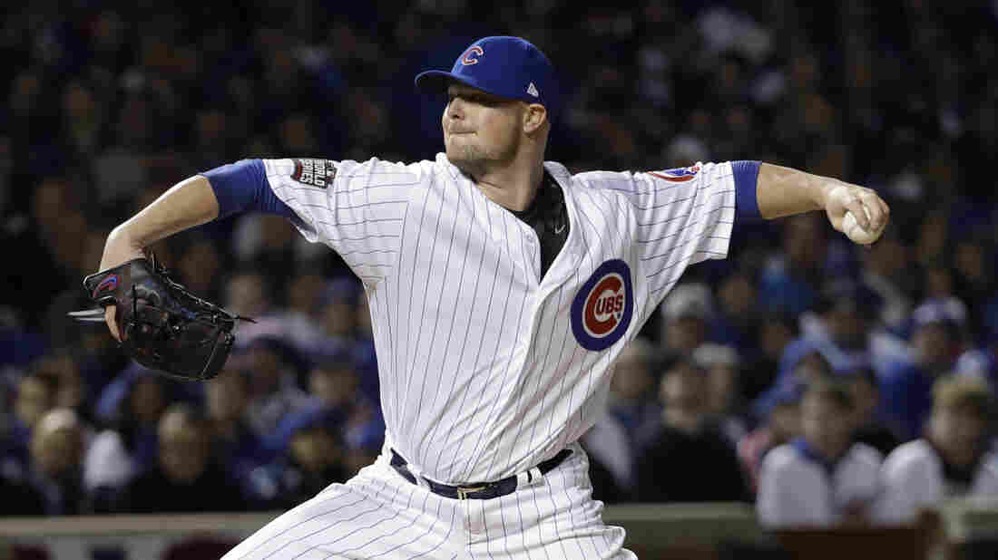 Chicago Cubs starter Jon Lester delivers a pitch in the first inning of Game 5 of the Major League Baseball World Series against the Cleveland Indians on Oct. 30, 2016, at Wrigley Field in Chicago.