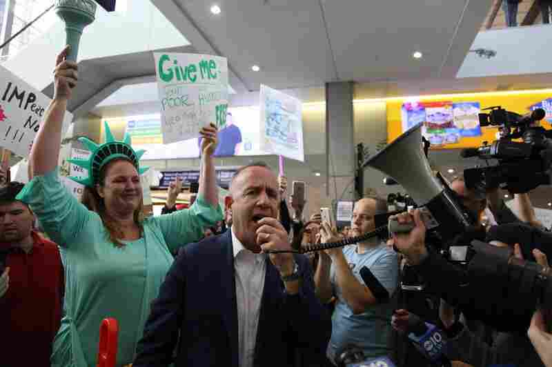 Sacramento Mayor Darrell Steinberg addresses protesters in Terminal B of the Sacramento International Airport in California.
