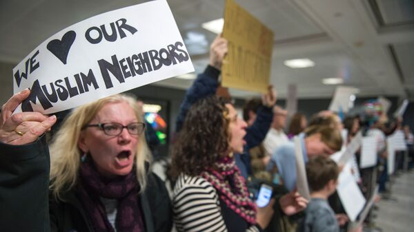 Protesters came to the international arrivals area of the Washington Dulles International Airport on Saturday.