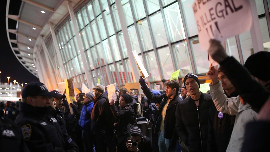 Activists stage a rally at John F. Kennedy International Airport in New York on Saturday against President Trump's order barring travelers from seven Muslim-majority countries for 90 days. (Anadolu Agency/Getty Images)