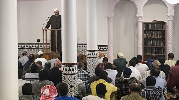 Tareq Oubrou, an imam in Bordeaux, delivers a sermon in French and Arabic at the city
