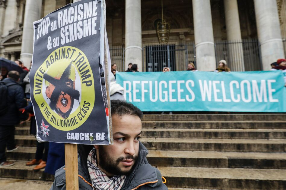 People protest against President Trump's executive immigration ban on Monday in Brussels, Belgium. (Thierry Roge/AFP/Getty Images)