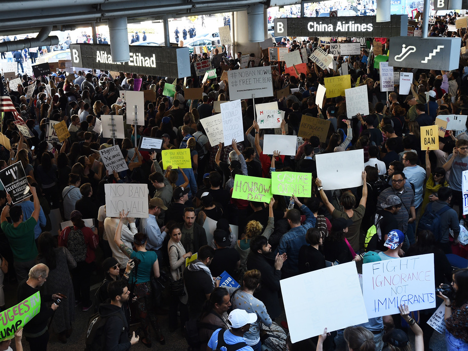 Protesters at Los Angeles International Airport rally Sunday against President Trump's executive order halting entry of refugees and others into the U.S. (Amanda Edwards/Getty Images)
