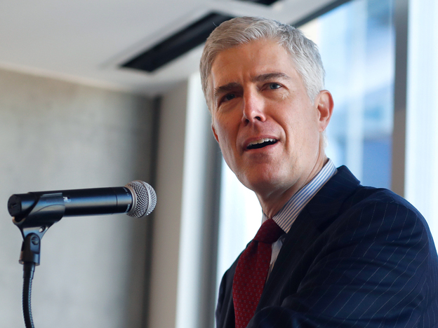 Judge Neil Gorsuch of the 10th U.S. Circuit Court of Appeals   makes a point while delivering prepared remarks before a group of attorneys last Friday at a luncheon in a legal firm in lower downtown Denver.