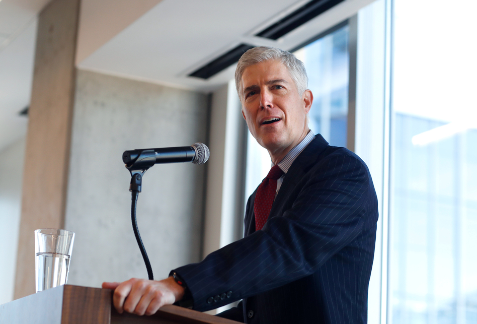 Judge Neil Gorsuch of the 10th U.S. Circuit Court of Appeals   makes a point while delivering prepared remarks before a group of attorneys last Friday at a luncheon in a legal firm in lower downtown Denver. (David Zalubowski/AP)