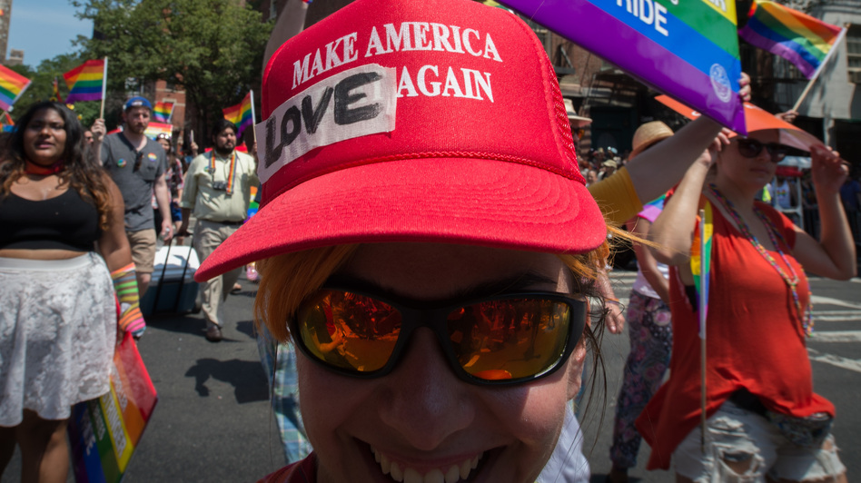 President Trump has decided to leave in place President Barack Obama's 2014 executive order protecting employees from anti-LGBTQ workplace discrimination while working for federal contractors. Here, a marcher in New York's Gay Pride march wears a modified version of a Trump campaign hat last summer. (Bryan R. Smith/AFP/Getty Images)