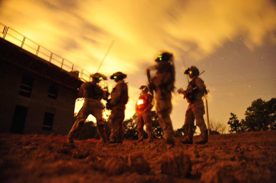 Navy SEALs participate in special operations urban combat training in 2012. The training exercise familiarizes special operators with urban environments and tactical maneuvering during night and day operations. (Mass Communication Spc. 2nd Class Meranda Keller/U.S. Navy)