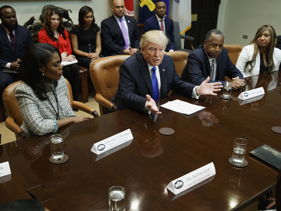 """President Trump, flanked by Omarosa Manigault and House and Urban Development Secretary nominee Ben Carson, holds an African-American History Month """"listening session"""" on Wednesday. (Evan Vucci/AP)"""