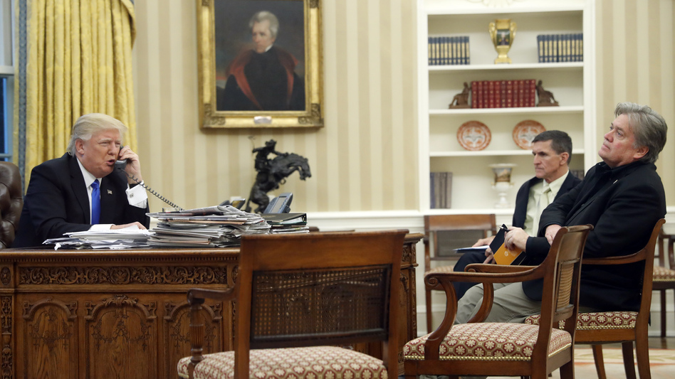 President Trump speaks on the phone with Australian Prime Minister Malcolm Turnbull, with national security adviser Michael Flynn (center) and chief strategist Steve Bannon in the Oval Office of the White House on Saturday. (Alex Brandon/AP)