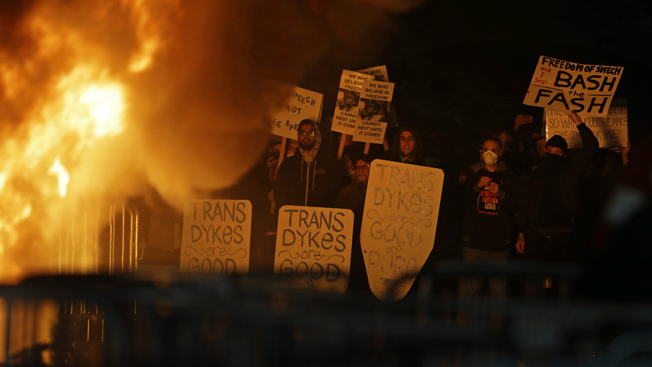 Protestors watch a bonfire on Sproul Plaza during a rally against the scheduled appearance of Milo Yiannopoulos at the University of California at Berkeley Wednesday. (Ben Margot/AP)