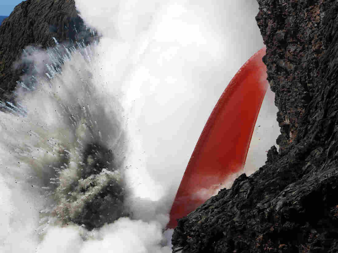 See a 'firehose' of lava shooting into the ocean