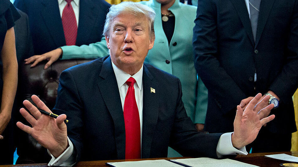 President Trump, surrounded by small-business leaders, speaks before signing an executive order in the Oval Office earlier this week. (Getty Images)
