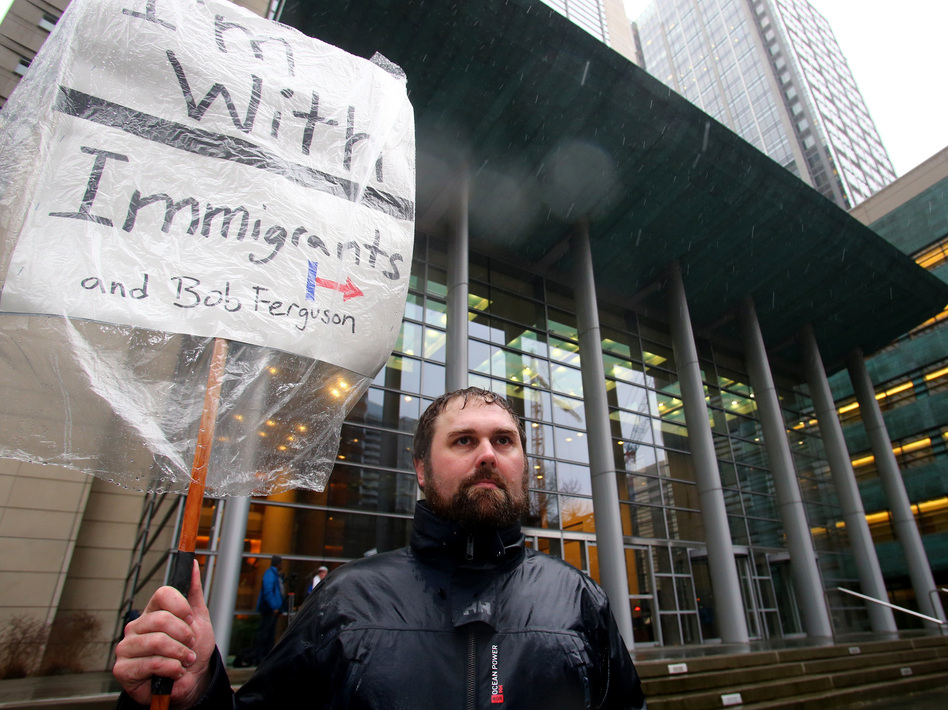 Patrick Wicklund, from Seattle, stands outside the U.S. District Court, Western Washington, on Feb. 3 in Seattle. Washington state Attorney General Bob Ferguson filed a state lawsuit challenging key sections of President Trump's immigration executive order as illegal and unconstitutional. (Karen Ducey/Getty Images)