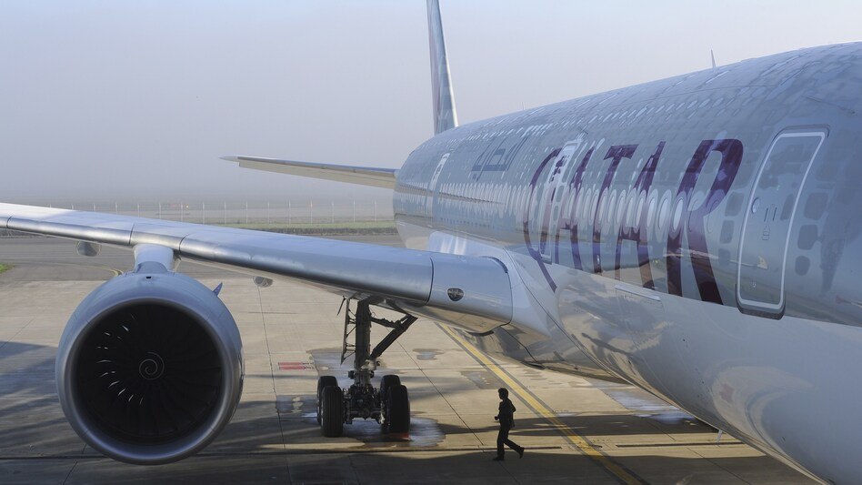 An Airbus A350-900 for Qatar Airways in 2014 in France. Qatar Airways is among the airlines that have announced they will resume boarding travelers affected by President Trump's executive order. (Eric Cabanis/AFP/Getty Images)